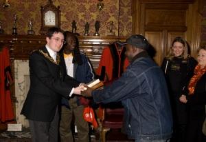 James presents the Croydon Mayor with a thank you box of Divine chocolates