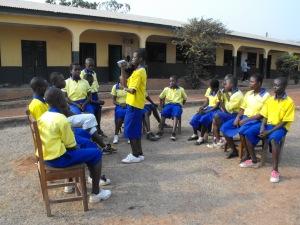Akumadan schoolchildren filming their webcast