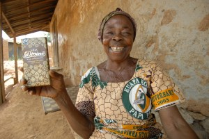 Farmer Adwoa Asianaa with a bar of Kuapa's Divine Chocolate