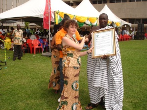 Divine MD Sophi Tranchell receives a special Citation from Kuapa Kokoo president Mr Buah, in recognition of the work Divine has done over its first decade