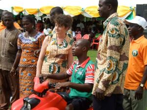 Handing over the keys to a quad bike to a disabled farmer who has spurred his society on to produce 2000 bags of cocoa