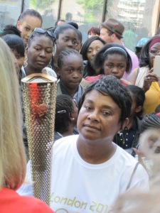 Sophi watches Doreen Lawrence being handed the Olympic Torch in Lewisham 23rd July 2012